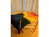 Hand knitted rainbow blanket