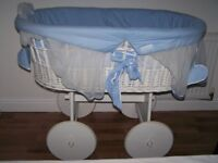 wicker crib on wheels, blue fabric around the basket, with mattress, from smoke and pet free home