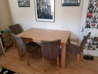 Table and chairs good condition selling only as moving