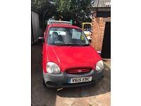 12 months MOT, four door in red. Ideal as first car