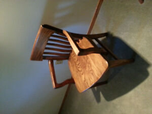 Four Antique wooden chairs for sale.