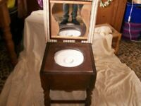 Commode converted into wash basin.