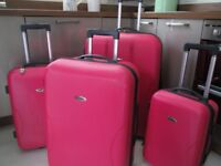 Suitcases - Could be sold as a set or as individual items.