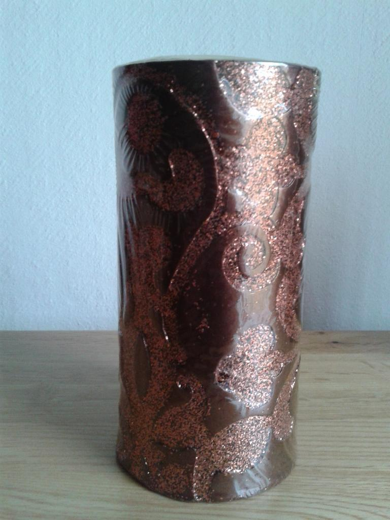 Pair of new and sealed bronze colour pillar candles