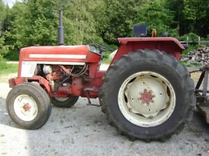 International 454 Tractor and John Deere 8250 Seed Drill