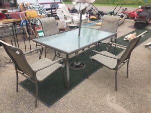 $140 - patio set.  Table, 4 chairs, umbrella and stand.