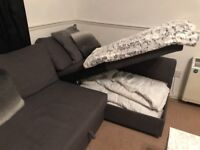 L Shaped sofa with extra storage and pull out bed