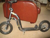 Childs scooter in good condition , chunky tyres and front and back brakes ,