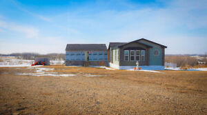 Quiet secluded Fort Qu'Appelle acreage with large bungalow!