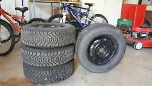 Four Goodyear Nordic winter tires on rims P185/70R14