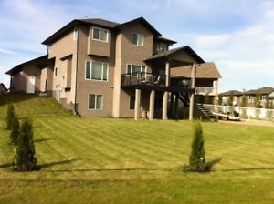 Executive walkout 3 bedroom lower level,utilities included