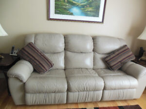 Three and one seat beige leather recliners very well maintained.