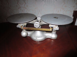 antique New York Detecto scale with 3 weights