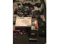 Huge retro games console joblot with accessories and games and a box of cables