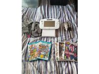 Wii u forsale, like new, with games.