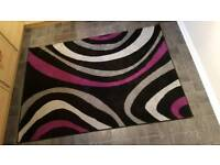 Black and purple swirl rug