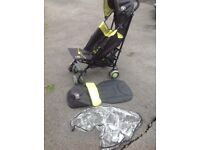 Red kite reclining stroller with rain cover and foot muff