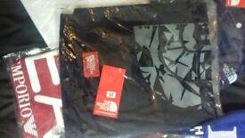 selling cheap desigmer t shirts north face. hugo boss. ea7