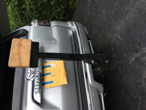 Outboard motor trailer hitch carrier