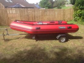Tohatsu 20hp outboard and Tohatsu 3.5m inflatable on Extreme trailer