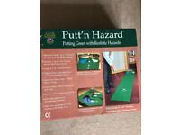 Putting green mat with electronic return ball