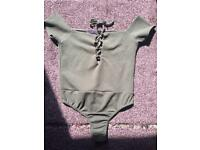 Green bodysuit size 8/10