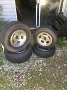 2 185/75R14, and 2 255/70R15 tires and rims