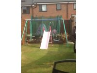 Swing and seesaw set with slide