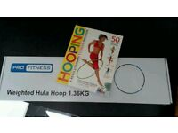 Weighted hula hoop and hooping exercise book