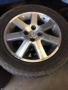 Mazda protege mags 4 bolts on tires good condition