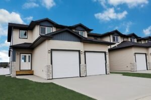 Beautiful New Unit With Finished Attached Garage In Penhold!