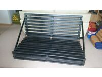 Futon base (two available). Sturdy design in black.