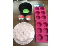 "Baking items: Muffin tins, muffin cases, 8"" cake tin and cake stand."