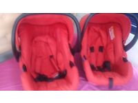 2 newborn car seats and two travel cots