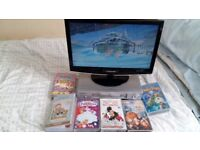 VHS recorder and children's films/ programes on video tapes