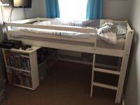 White wooden mid sleeper with slide out desk