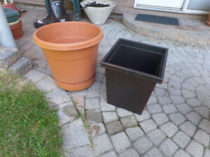 2 large planters, one square one round, $15 each or $25 for both