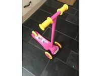 Pink children's scooter