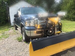 2005 F250 4x4, with Fisher snowplow