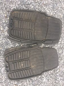 A pair of front Rubbermaid winter floor mats