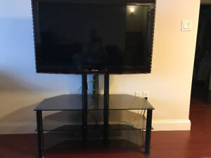 Three-shelf smoked glass stand for large TV $225