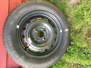 Small car tires on steel rims for sale