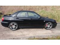 Subaru Impreza WRX, black, low mileage