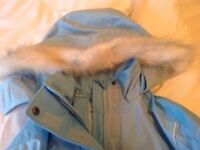Ski jacket, age 13-14 pale blue with fur-trimmed hood in excellent condition