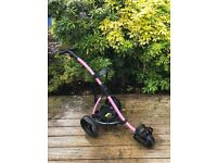 Pink Motocaddy golf trolley