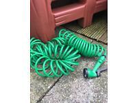 Green spray curly hose