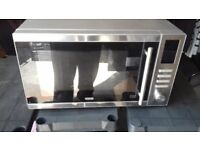 new silver delongie microwave ovan