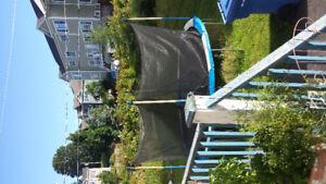 Trampoline 14 pieds avec filet très bonne condition