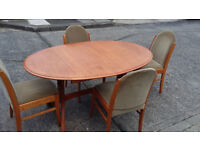 Brown Wood Extending Dining Table And 4 Chairs