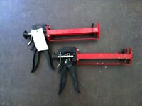 Two Red Heavy Duty Resin Guns - One New one Used Condition - ideal for builders or Do It Yourself..
